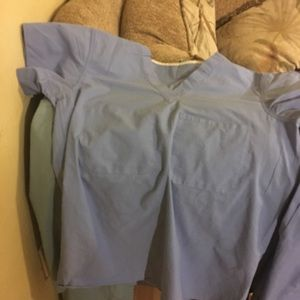 Four used hospital scrubs sets unisex size small